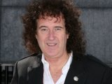 Brian May hints that a Queen version of Guitar Hero is in the works.