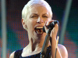 Annie Lennox has addresses questions concerning her 'HIV Positive' slogan T-shirt.