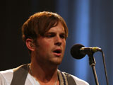 Kings of Leon singer Caleb Followill reveals that he almost fell unconscious when getting a tattoo.