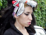Amy Winehouse leaving her home to visit her husband Blake in prison, London