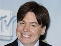 Austin Powers star Mike Myers reportedly ties the knot with girlfriend Kelly Tisdale.