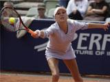 Anna Kournikova on court playing tennis, hitting a tennis ball