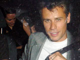 Richard Bacon in a car with three girls, London