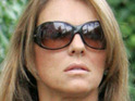 "Liz Hurley is spotted looking ""nervous"" at Heathrow Airport, prompting rumors of a visit to ex-lover Shane Warne."