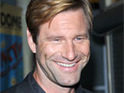 Aaron Eckhart says that Battle: Los Angeles has the same feel as The Dark Knight.