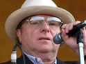 Van Morrison is announced as the headline act on an extra day at the Hop Farm festival.