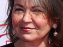 Roseanne Barr says that the couple who live next door to her Hawaiian farm have threatened her safety.