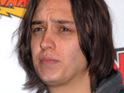 "Julian Casablancas admits that playing solo is ""liberating"" and that his loyalties are ""split""."