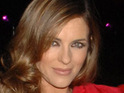 Actress Liz Hurley  reveals that she still speaks to ex-boyfriend Hugh Grant on a regular basis.