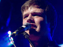 "White Lies frontman Harry McVeigh says that he wants to follow Kings of Leon's ""career path""."