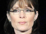 Sarah Palin blinks back tears as John McCain concedes defeat at the Republican election night rally in Arizona