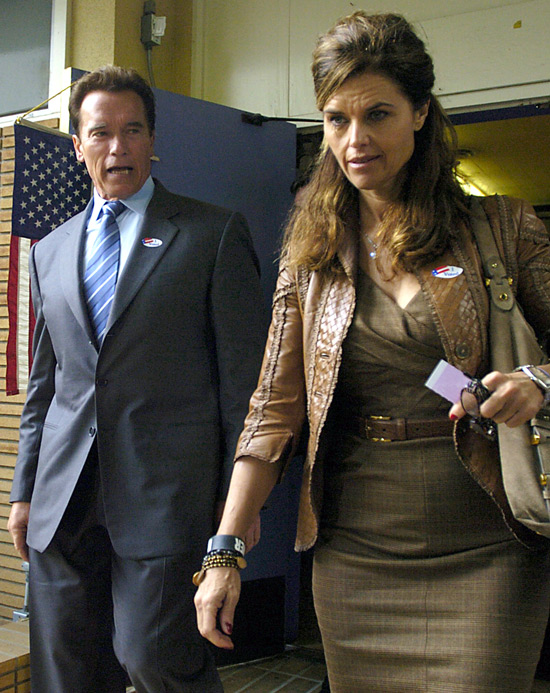 McCain supporter, Governor Arnold Schwarzenegger and his wife, Maria Shriver leaving a polling station in California