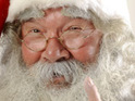 A city drops plans for a communal Santa Claus after complaints from of Roman Catholic archbishop.