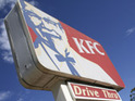 A chicken is put through a KFC drive-thru hatch.