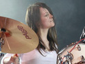 White Stripes frontman Jack White defends criticism of drummer Meg's musical ability.