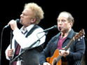 Simon and Garfunkel surprise fans by appearing at a tribute concert in New York.