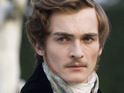 Rupert Friend recalls how bullies burned him with cigarettes during his school years.