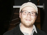 Seth Rogen leaves Madeo restaurant in a good mood.