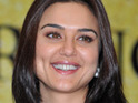 The manager of cricketer Brett Lee denies that his client is romantically linked with Preity Zinta.