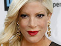 Tori Spelling claims that the late Farrah Fawcett visited her from beyond the grave.