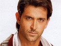 Hrithik Roshan is hiding his swollen face from his sons, following an allergic reaction.