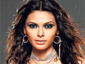 Sherlyn Chopra reportedly refuses to take off her sunglasses for photographers in Sri Lanka.