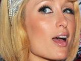 Paris Hilton and Peaches Geldof pose for cameras at the 'Hollywood Domino Party' in Cannes