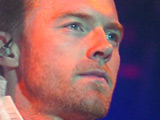 Ronan Keating grapples a dancer during Boyzone's reunion concert in Belfast