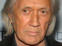 David Carradine's widow claims that French production company MS2 S.A. is at fault for her husband's death.