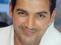 John Abraham insists on continuing work on his new film, despite fracturing his hand performing a stunt.