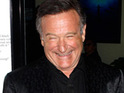 Robin Williams raises over $400,000 by hosting a dinner party for six fans.