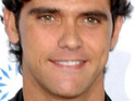 Aussie tennis player Mark Philippoussis is believed to have split from Bradley Cooper's ex-wife.