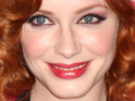 Playboy posts pictures of Christina Hendricks posing in a silver bikini early in her career.