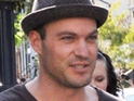 Brian Austin Green admits that though he loves acting, he dislikes his celebrity status.