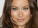 Tron: Legacy star Olivia Wilde reveals that her husband doesn't mind when she films love scenes.