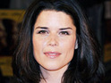 Actress Neve Campbell maintains that she is holding up well after recently filing for divorce.
