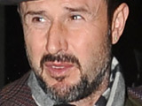 David Arquette attempts to avoid fans and photographers while leaving his hotel in Midtown, New York City
