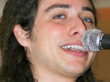 Jason Castro, season 7 of American Idol, performs and signs autographs during his pre-release tour at the Sawgrass Mills Mall Sunrise, Florida