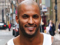 Hollyoaks star Ricky Whittle reacts to his success at the 2010 TRIC Awards.
