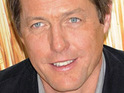 Hugh Grant offers to buy a bar full of students a drink during a visit to Oxford University.