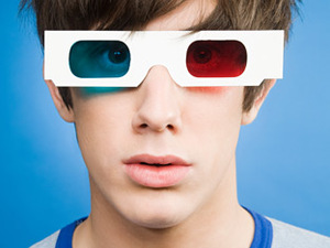 A teenager wearing 3D glasses