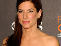 Sandra Bullock is named 'Woman of the Year' after the actress endured a turbulent 12 months.