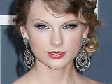 Taylor Swift looking stunning on the red carpet of the 52nd Annual Grammy Awards