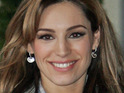 Kelly Brook says that she almost ruined her favorite Hermes handbag by throwing up in it.