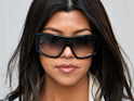 Kourtney Kardashian denies reports that her boyfriend was flirting with one of her friends.