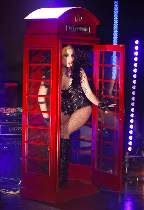 Lady GaGa in a telephone box