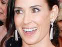 "Demi Moore says that she wanted to ""push the boundaries"" with her iconic naked pregnant snap."