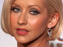 Christina Aguilera dismisses reports that her divorce was due to domestic violence.