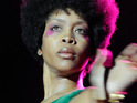 Erykah Badu is charged with disorderly conduct after stripping off at the spot where JKF was killed.