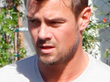 Josh Duhamel stops at a gas station to refuel his truck